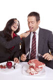 Couple eating her feeding him Royalty Free Stock Photo