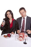 Couple eating him looking at her food Royalty Free Stock Photography