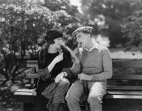 Couple eating ice cream cones in park. (All persons depicted are no longer living and no estate exists. Supplier grants that there will be no model release royalty free stock images