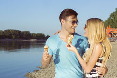 Couple eating ice cream and having fun at the beach Royalty Free Stock Images