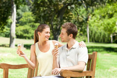 Couple eating an ice cream in the park Royalty Free Stock Photo