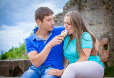 Couple eating ice cream at park Royalty Free Stock Photos