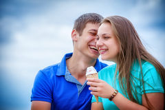 Couple eating ice cream at park Royalty Free Stock Photography