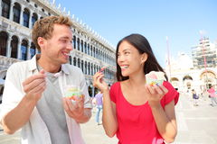Couple eating ice cream on vacation, Venice, Italy. Couple eating ice cream on vacation travel in Venice, Italy. Smiling happy young couple in love having fun stock images