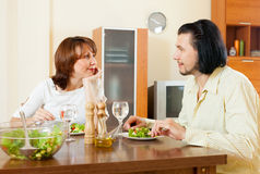 Couple eating juicy vegetables and herbs in the home Royalty Free Stock Photography