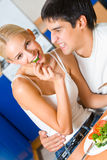 Couple eating at kitchen Royalty Free Stock Image