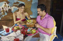 Couple Eating Meal At Outdoor table Royalty Free Stock Photography