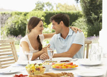 Couple Eating meal Outisde Royalty Free Stock Photos
