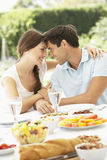 Couple Eating meal Outisde Royalty Free Stock Photo