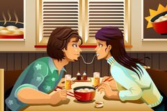 Couple Eating Noodle Stock Images