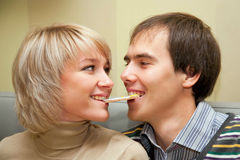 Couple eating one cookie Stock Photo