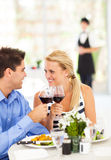 Couple eating out. Happy young couple eating out in restaurant Stock Photography