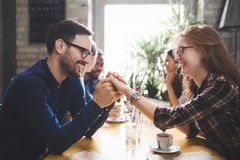 Couple eating out and dating in restaurant. Flirting coworkers eating out and dating in restaurant Stock Photography