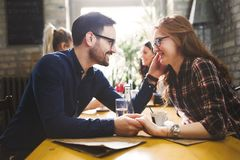 Couple eating out and dating in restaurant Stock Photos