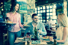 Couple eating out in restaurant Royalty Free Stock Image