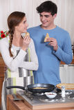 Couple eating pancakes Stock Image
