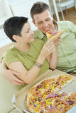 Couple eating pizza Stock Photography