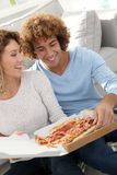 Couple eating pizza Stock Image