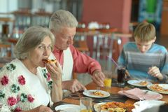 Couple eating pizza Stock Photos