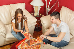 Couple eating pizza Royalty Free Stock Photo