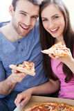 Couple eating pizza Stock Images