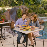 Couple eating at poolside 2 Stock Photos