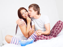 Couple eating popcorn Royalty Free Stock Image