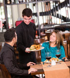 Couple eating at a restaurant Royalty Free Stock Images