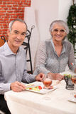 Couple eating at a restaurant Royalty Free Stock Photography