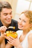 Couple eating salad stock photos