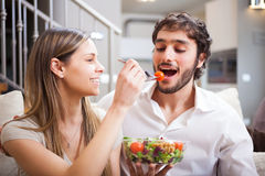 Couple eating a salad Royalty Free Stock Photo