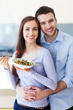 Couple eating salad. And smiling stock photography