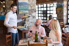 Couple eating salads in restaurant Royalty Free Stock Image
