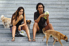 A couple eating while sitting on the stairs Royalty Free Stock Photo