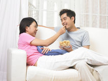 Couple eating snack Stock Photos