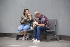 Couple eating Snacks Royalty Free Stock Image