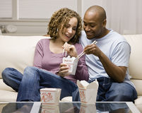 Couple eating take-out Chinese food