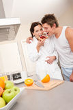 Couple eating toast in the kitchen Stock Photo