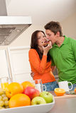 Couple eating toast in the kitchen Royalty Free Stock Photography