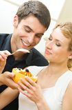 Couple eating vegetable salad royalty free stock photography
