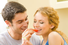 Couple eating vegetables Stock Photo