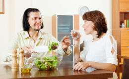 Couple eating vegetarian salad with water Stock Photography