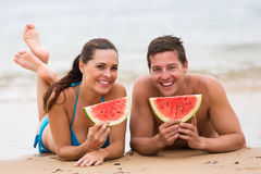 Couple eating watermelon Stock Photos