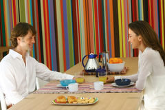 Couple eats breakfast together l Stock Images