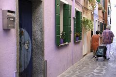 Couple of elderly people. A couple of elderly people in the streets of Murano Stock Image