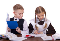 A couple of elementary school students sit at a desk Royalty Free Stock Photo