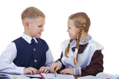 A couple of elementary school students sit at a desk Stock Photos