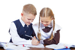 A couple of elementary school students sit at a desk Royalty Free Stock Photos