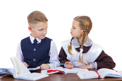 A couple of elementary school students sit at a desk Royalty Free Stock Image