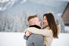 Couple embrace as they gaze at each other Stock Image